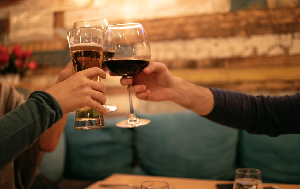 People toasting at happy hour.